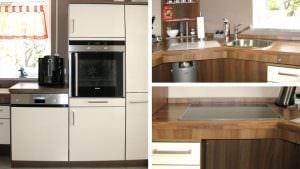 Arbeitsplatte manuell höhenverstellbar. Anordnung der Funktionen Kochen, Spülen und Vorbereiten über 135° Ecke.
